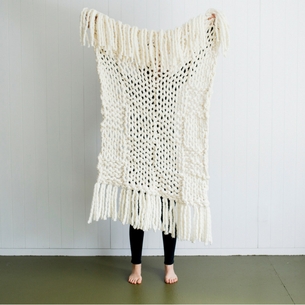 Add tassels to your giant knitted piece