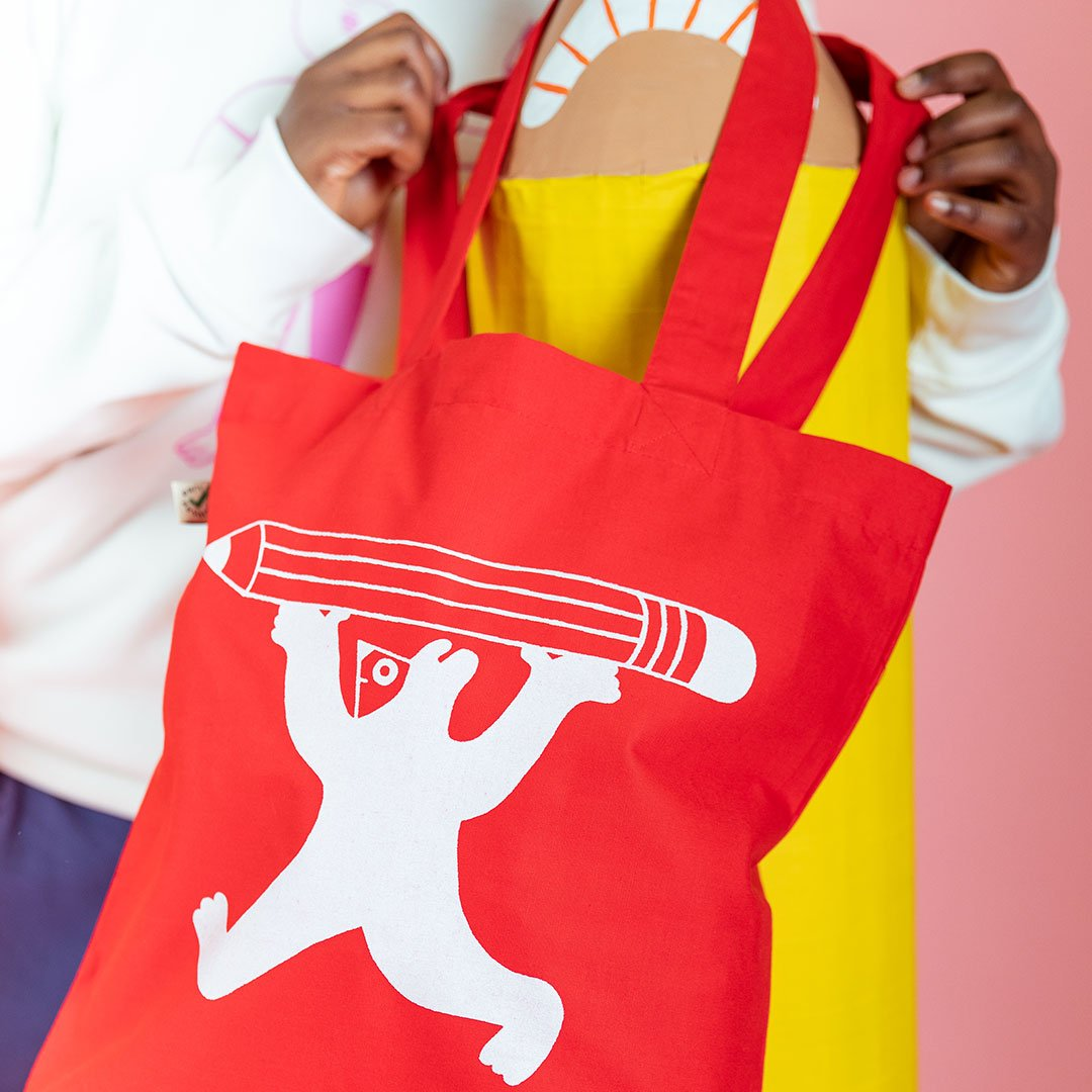 Cool red tote bag featuring cute illustration by YUK FUN