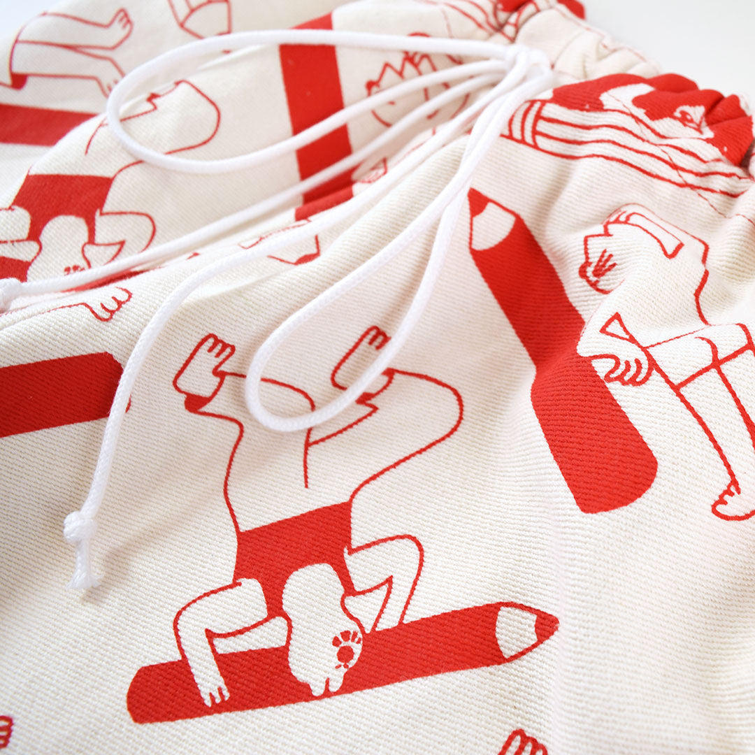 Close up detail of the hand screen printed 100% organic cotton by YUK FUN