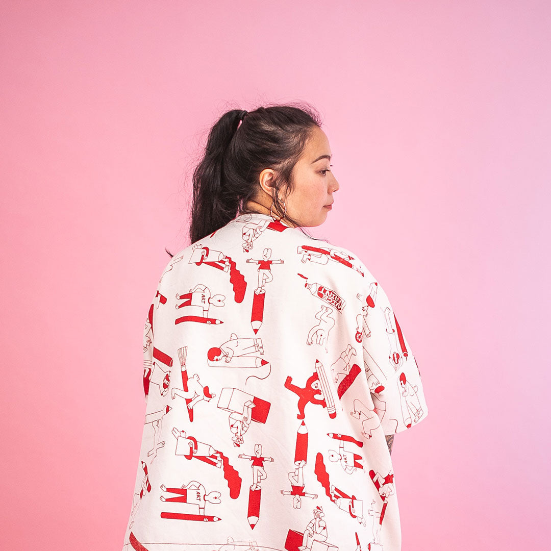 Red Artist Suit jacket from the back, hand screen printed with all over pattern of creative characters by YUK FUN