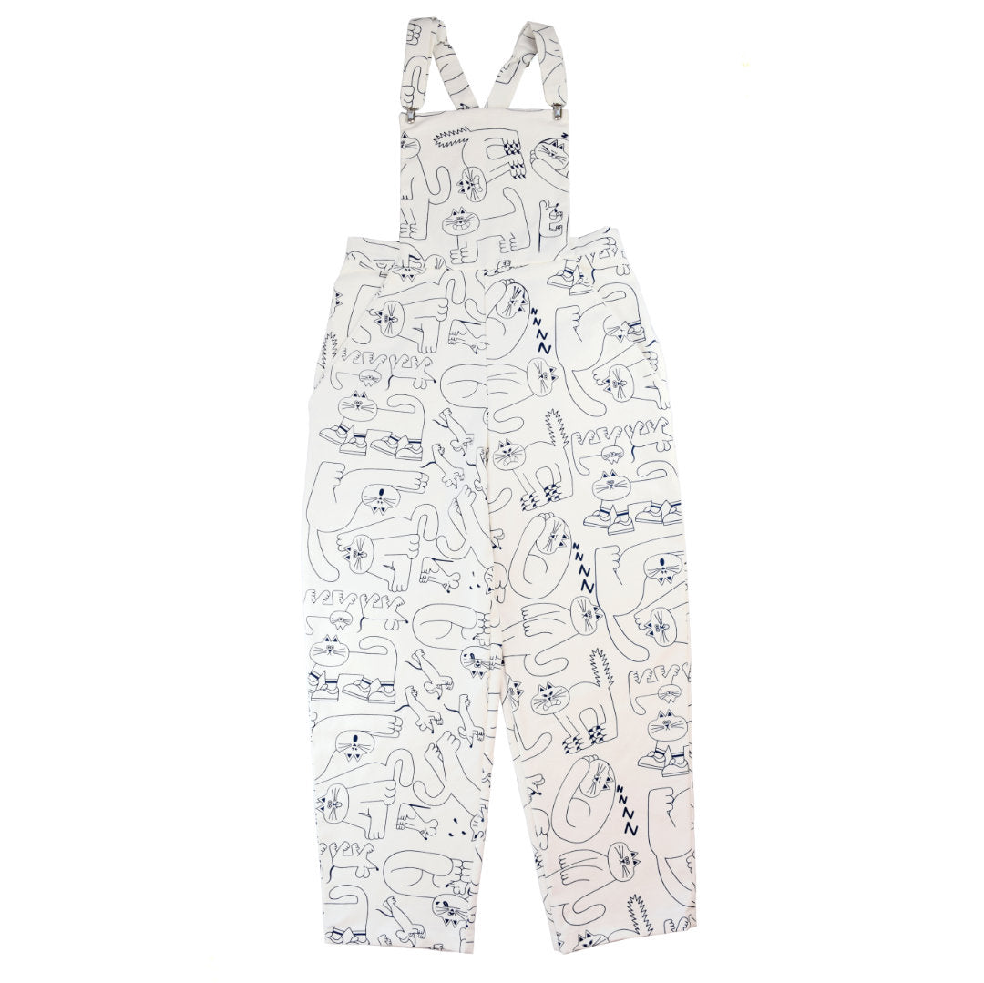 White cat dungarees made from sustainable deadstock fabric hand printed by YUK FUN and ethically made by The Emperor's Old Clothes