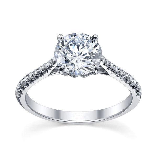 Engagement Rings – round brilliant cut diamond solitaire ring with side diamonds