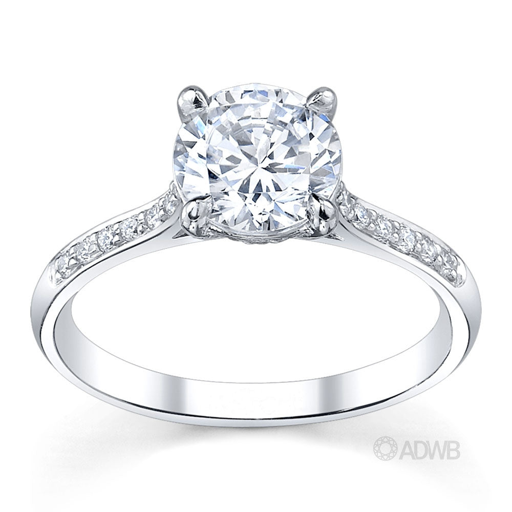 Caroline 4 claw round brilliant cut diamond solitaire ring with grain set diamonds in the band