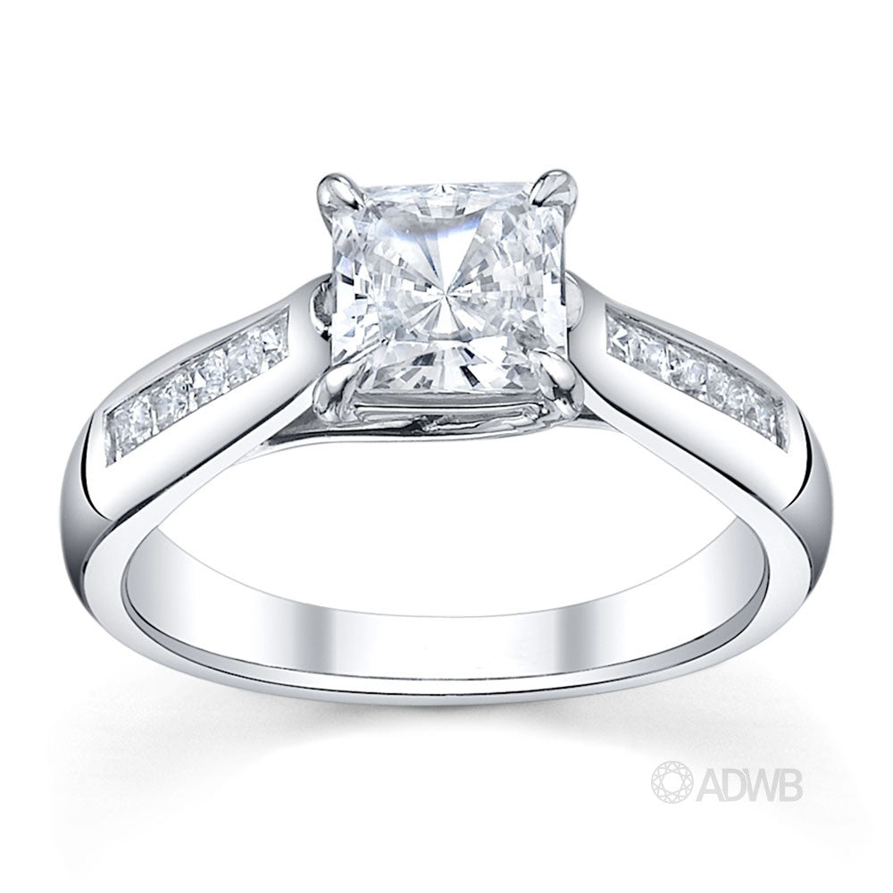 Cross prong princess cut ring with channel set princess cut side diamonds tapered out band