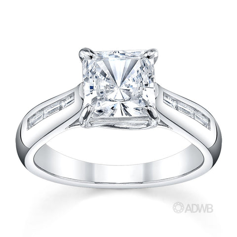 Cross prong princess cut ring with channel set baguette diamonds