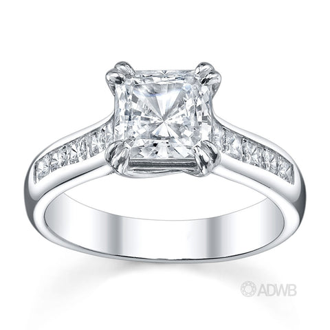 Cross double prong princess cut ring with channel set princess cut side diamonds