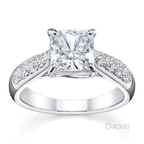 Cross claw solitaire princess cut diamond ring with tapered round brilliant cut diamond pave set band
