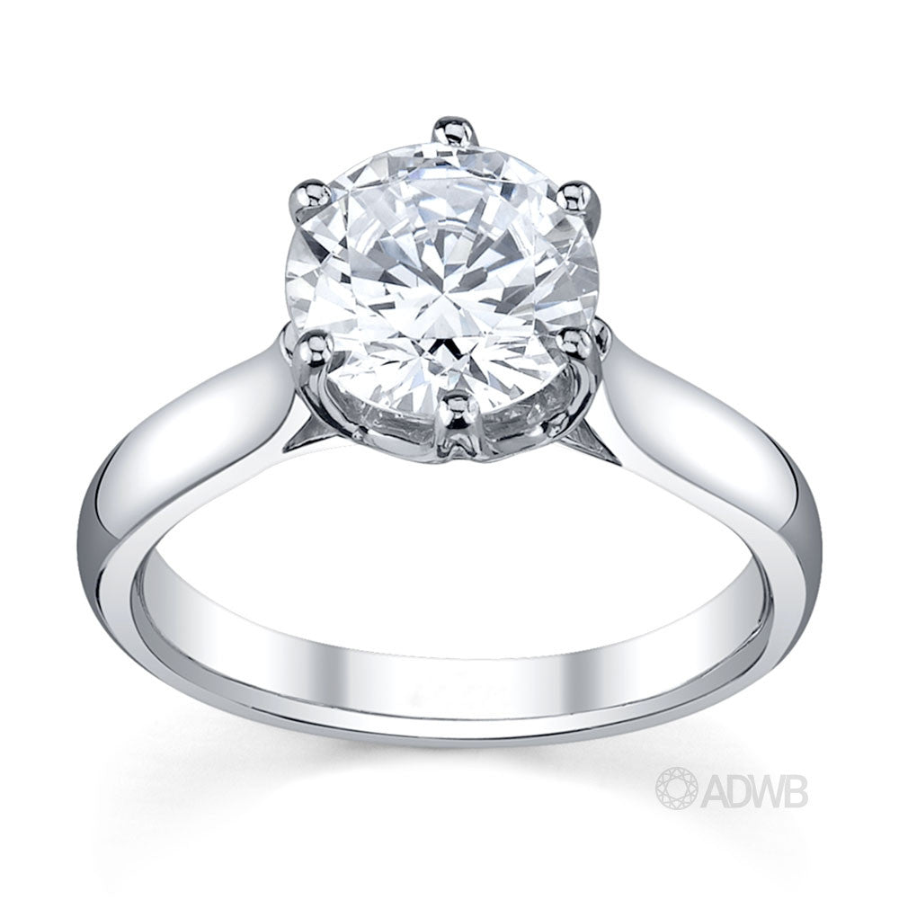 Custom made royal crown round brilliant cut diamond engagement ring
