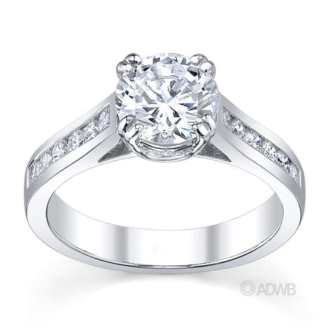 Coco double claw round brilliant cut diamond solitaire ring with channel set diamond band