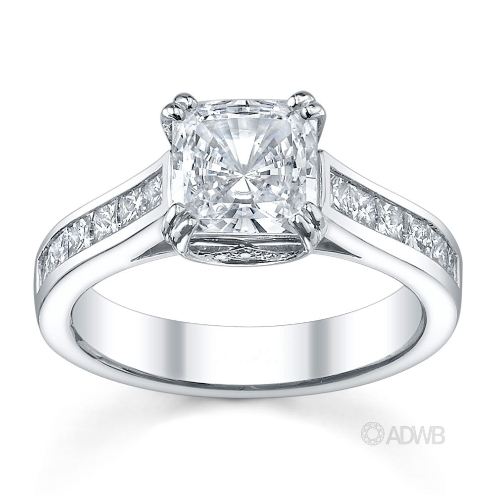 Double prong cushion cut ring with channel set princess cut diamonds