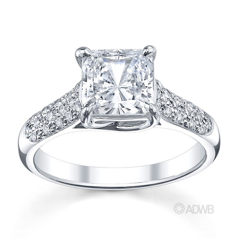 Cross claw princess cut ring with round brilliant cut diamonds pave set band