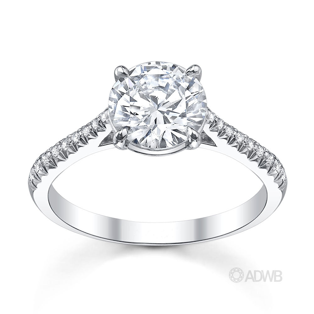 traditional round brilliant cut diamond ring with micro pave set diamond band