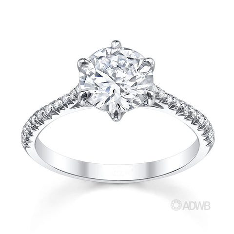 Classic 6 claw round brilliant cut diamond ring with french pave set diamond band