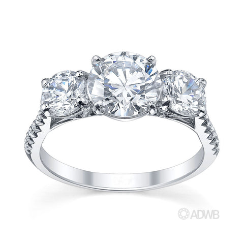 Classic 3 stone round brilliant cut diamond ring with micro pave set diamond band