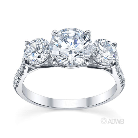 3 stone round brilliant cut diamond engagement ring with a micro pave set band