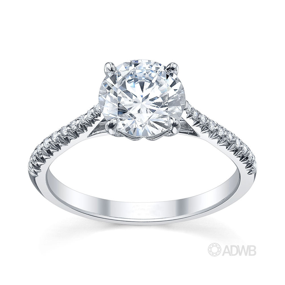 Coco 4 claw round brilliant cut diamond solitaire ring with pave set diamond band