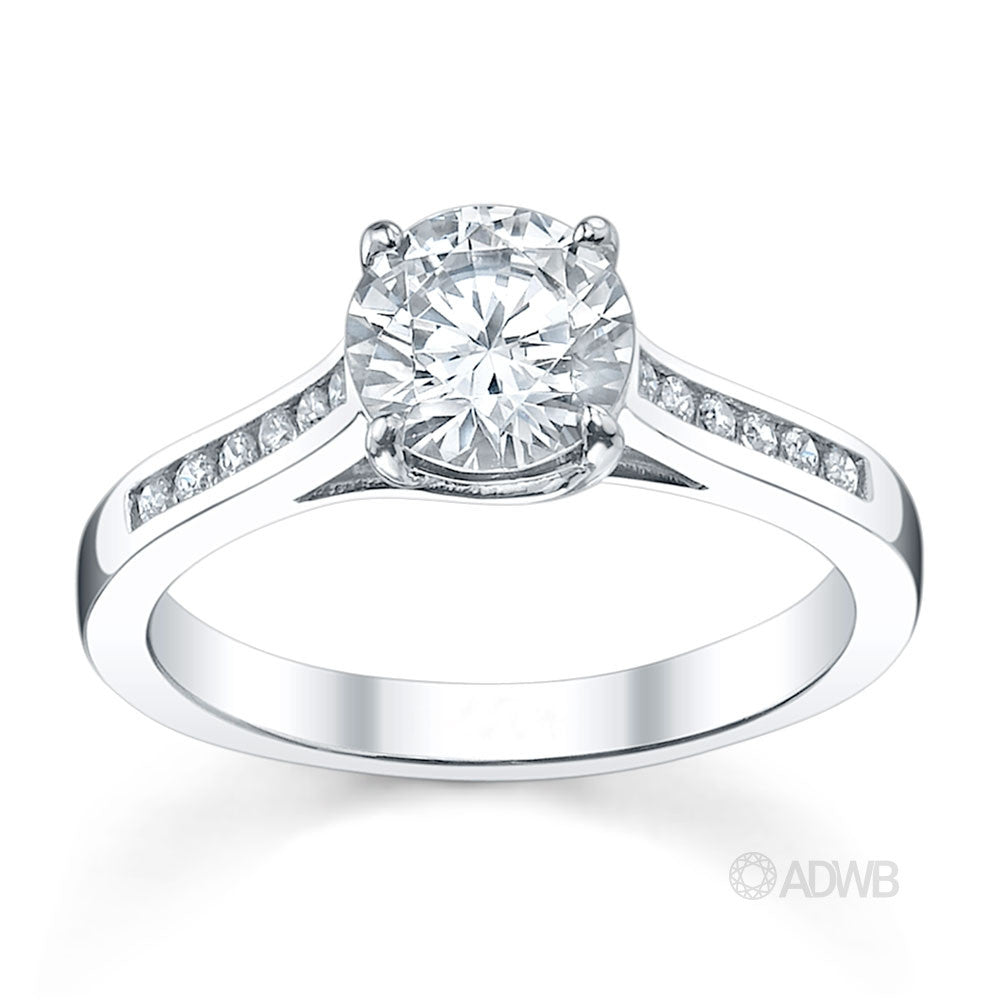 Monaco 4 claw diamond solitaire engagement ring with channel set diamond band