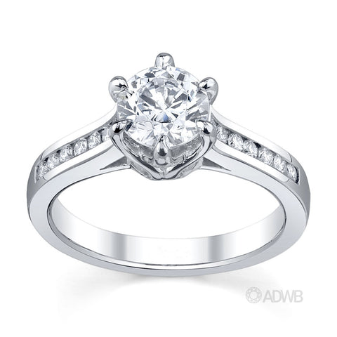 Elegant 6 claw round brilliant cut diamond solitaire ring with channel set band
