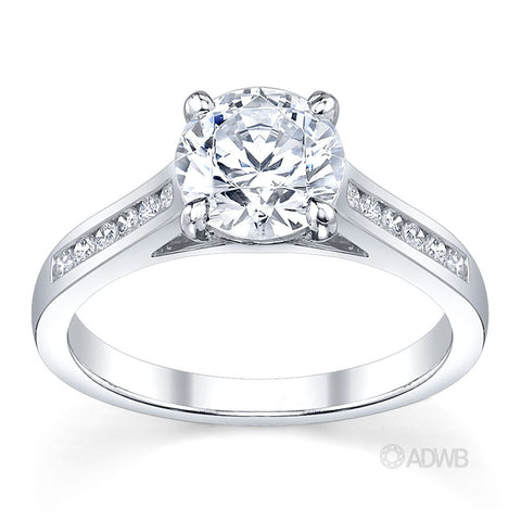 Caroline 4 claw round brilliant cut diamond solitaire ring with round brilliant cut channel set diamond