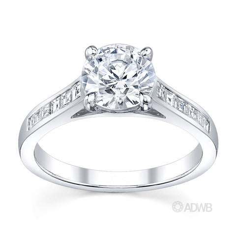 Caroline 4 claw round brilliant cut diamond solitaire ring with princess cut channel set diamond