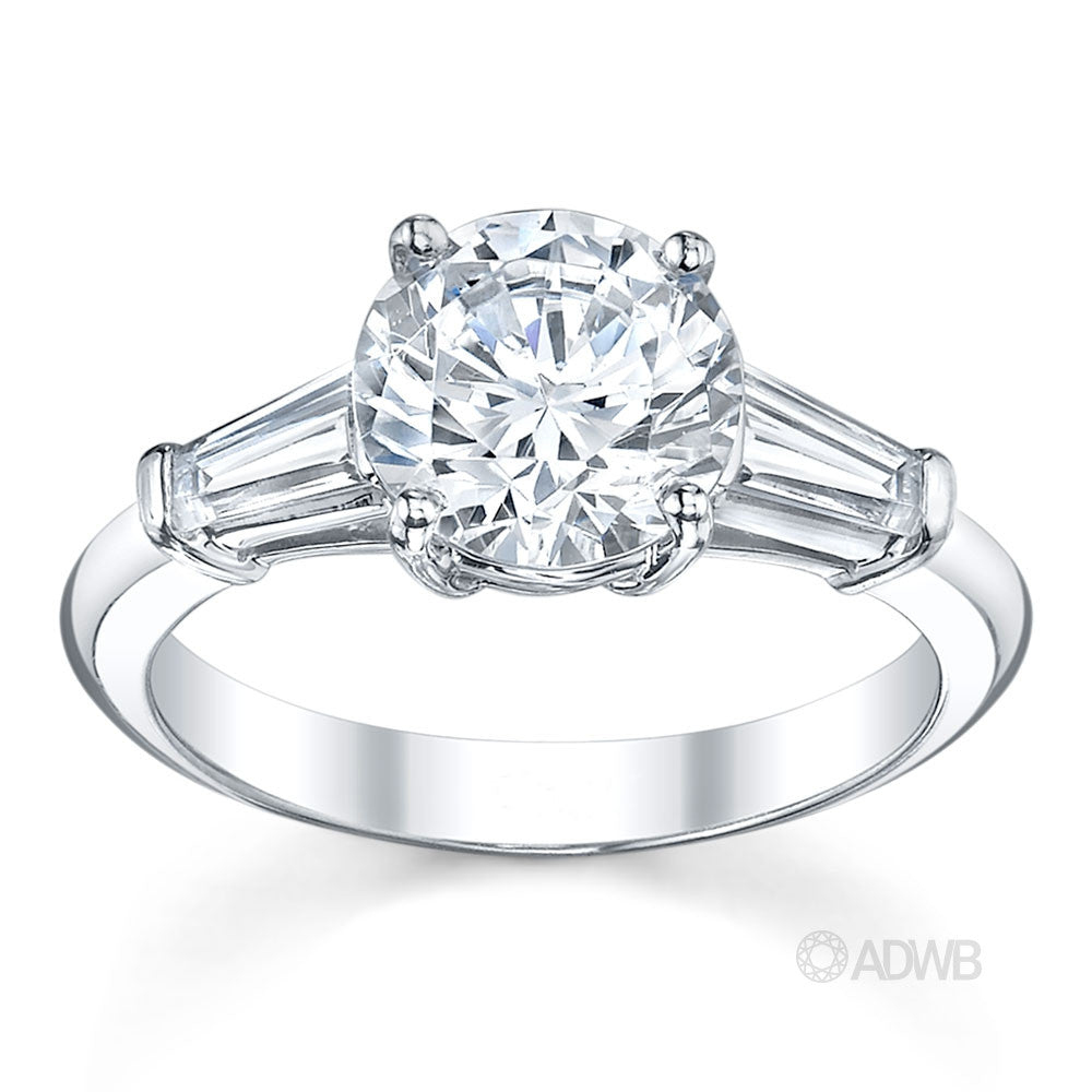 3 stone round brilliant tapered baguette cut diamond engagement ring