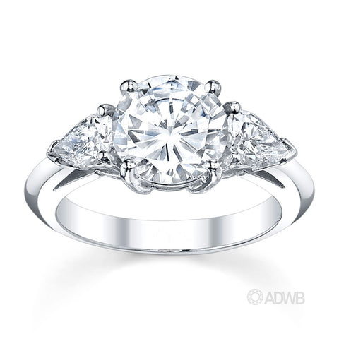 3 stone round brilliant and pear cut diamond engagement ring