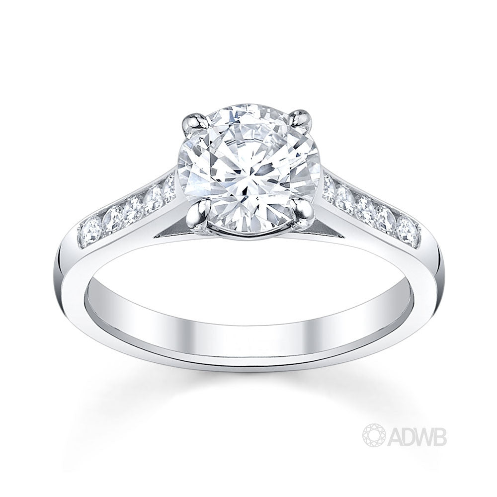 traditional round brilliant cut diamond engagement ring with channel set diamond band