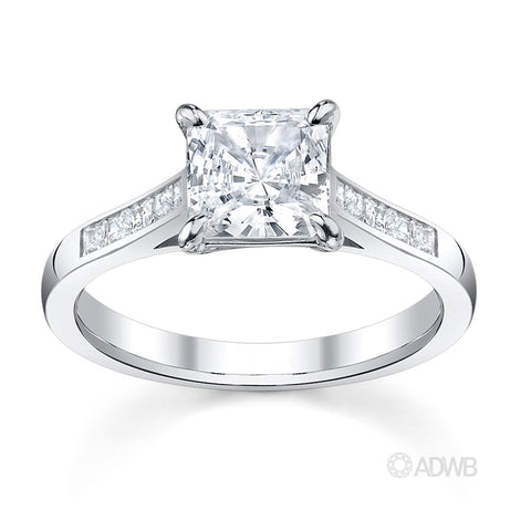 Classic Princess cut diamond ring with channel set diamond band