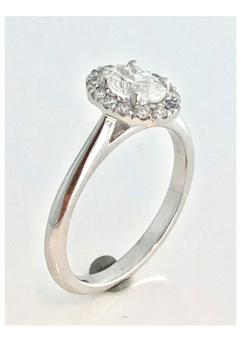 0.51ct Oval cut diamond halo ring in 18ct white gold