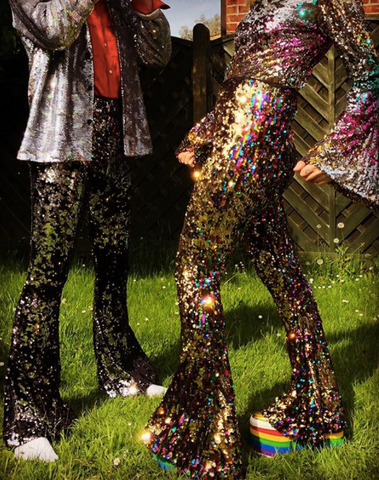 Man and woman wearing sequin flared trousers
