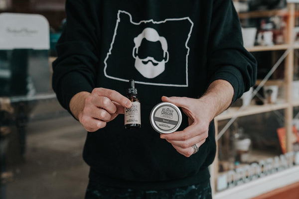 We Know Beards. Sweatshirt with white Bearded Oregon logo and displaying bearded oils and beard balm.