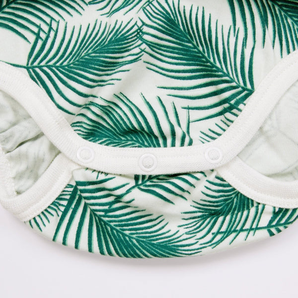 GOTS organic cotton onesie with green leaves print