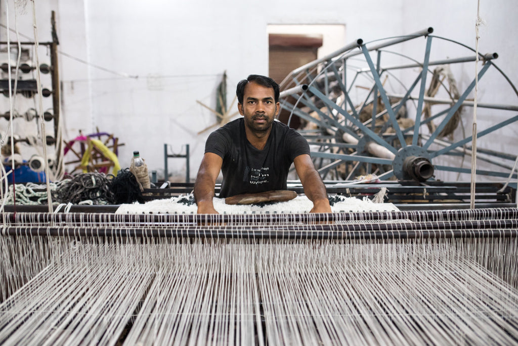 indian weaver on the loom