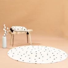 Styled shot Going Dotty Black washable cotton rug and cushion set