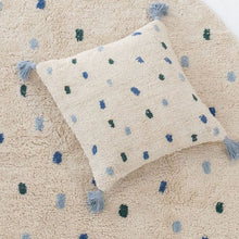 Close up cotton berber cushion on matching rug blue and green dots
