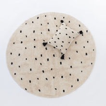 Going Dotty Black rug and matching cushion by Oh Happy Home