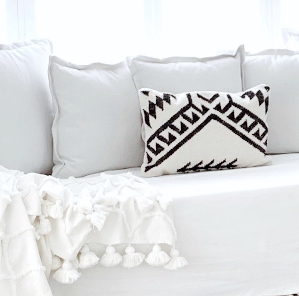 Maleek Handwoven Cushion styled on a white sofa - Oh Happy Home
