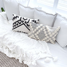 Maleek and Grey Morroccan Trellis cushions styled on a white sofa - Oh Happy Home