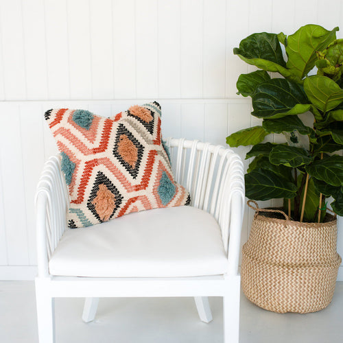 Cushion Pink Sahara styled on a white chair by Oh Happy Home