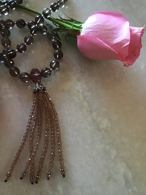 The Blissful Being Mala in celestial smokey quartz has an exquisitely beaded crystal tassel and separators. Tassel view.