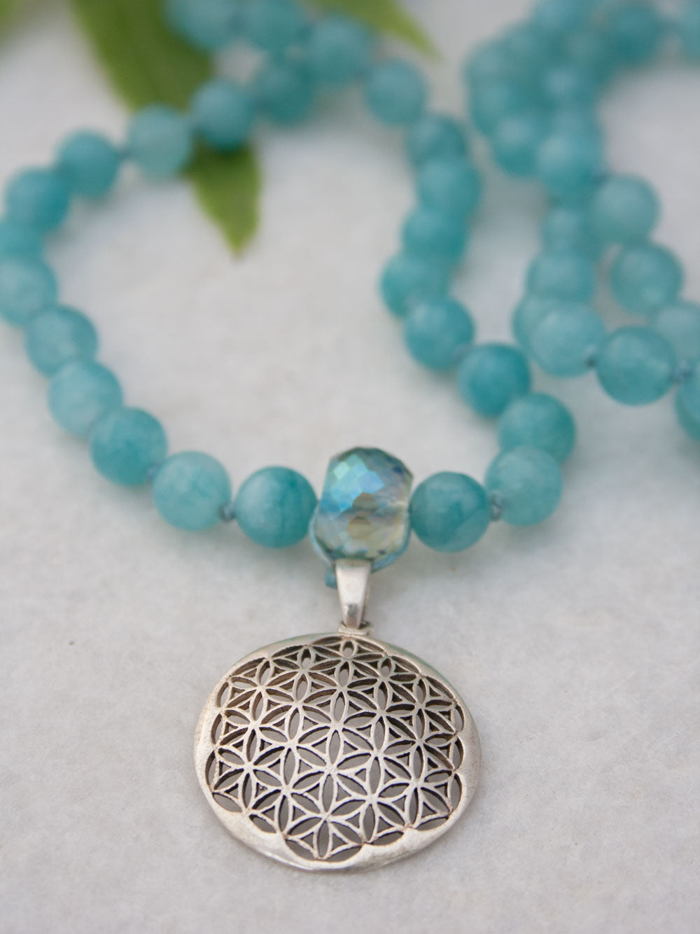 Babylonian Flower Mala in aqua blue aventurine has crystal Guru and 925 silver flower of life. Pendant view.