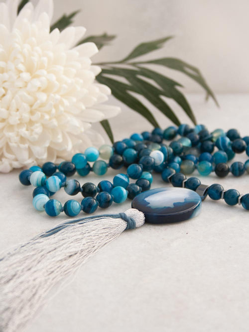 On My Merry Way Mala, in cerulean swirl onyx/agate, has an amazing onyx/agate oval and metallic silver tassel: coiled view