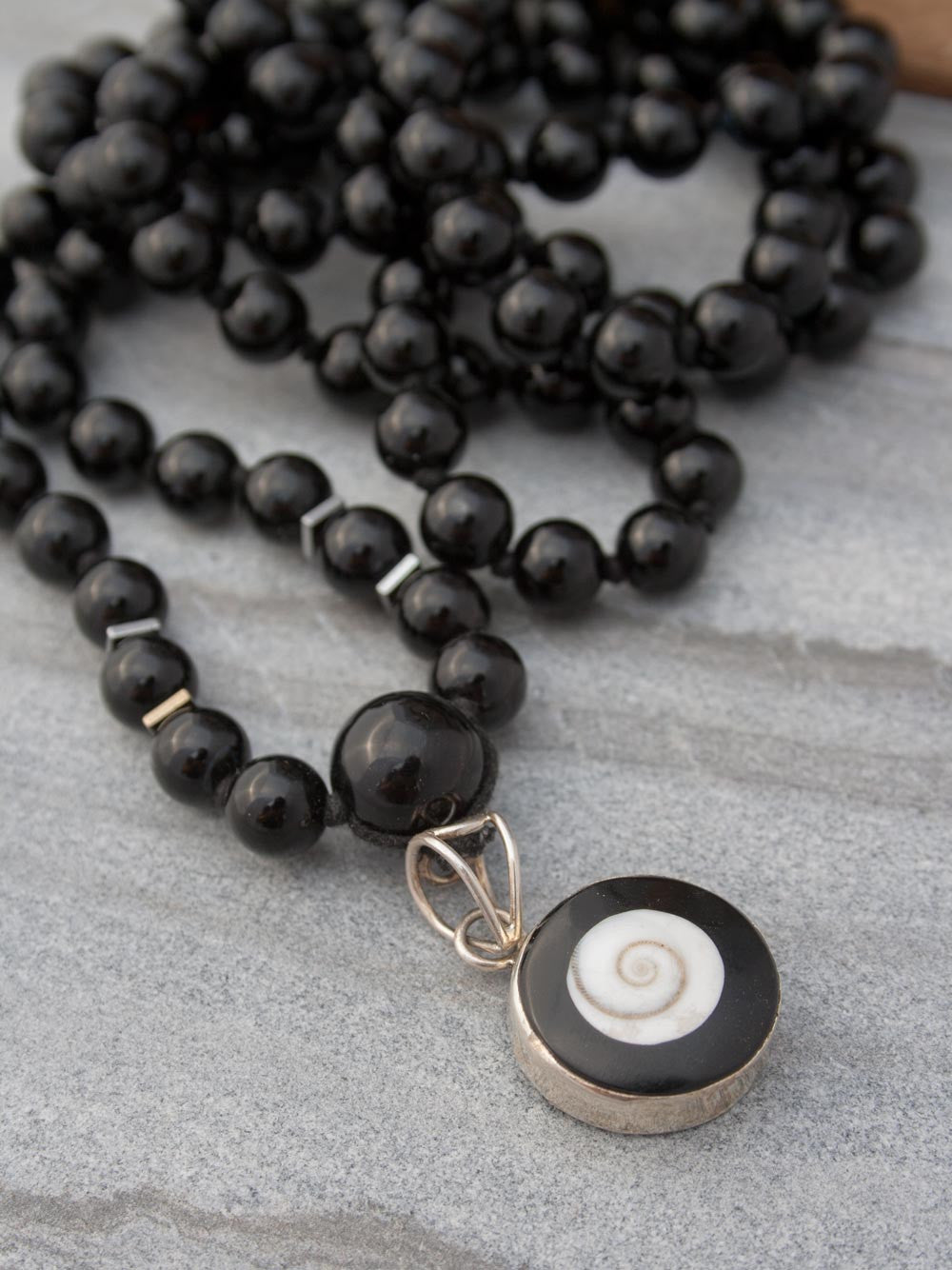 Absolute Bliss Mala, in obsidian onyx, has an ivory shell,  black onyx & silver Shiv Eye pendant: alternate view of Shiv Eye
