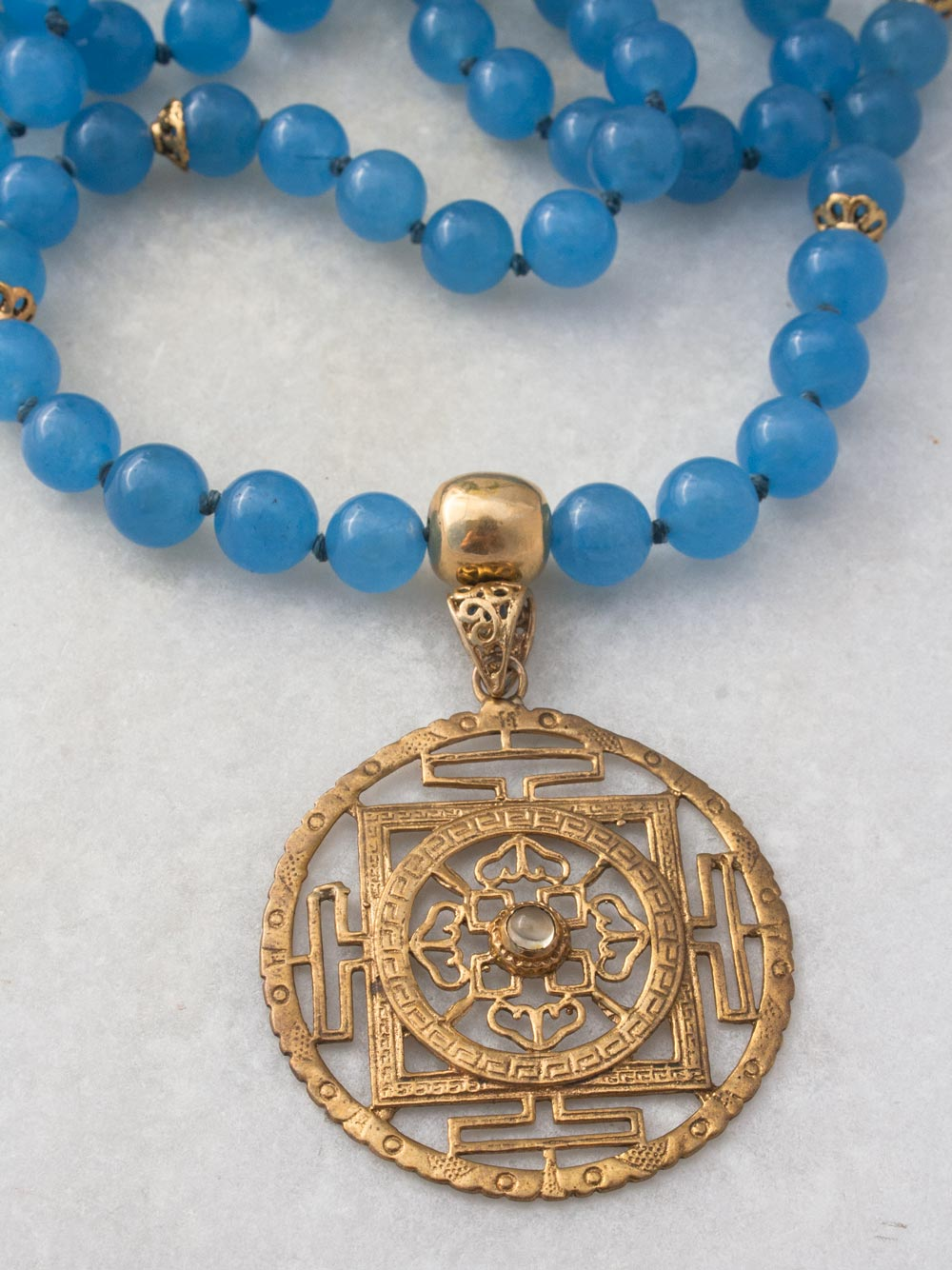 Beyond Infinity Mala, in 10mm Avalon blue aventurine, with brass Guru and Mandala. Guru and Mandala alternate view.