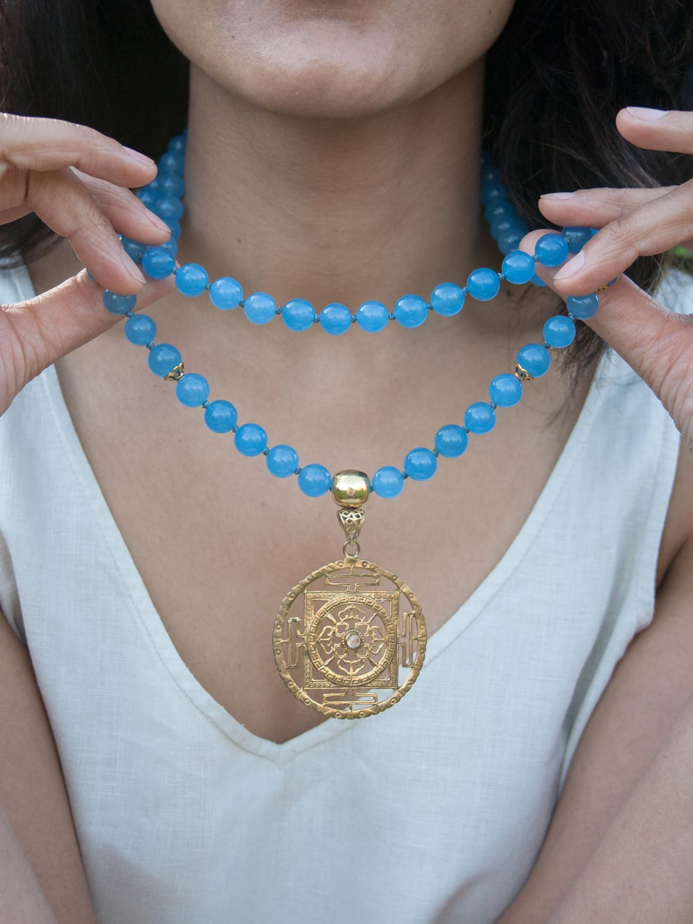 Beyond Infinity Mala, in 10mm Avalon blue aventurine, with brass Guru and Mandala. Necklace view.