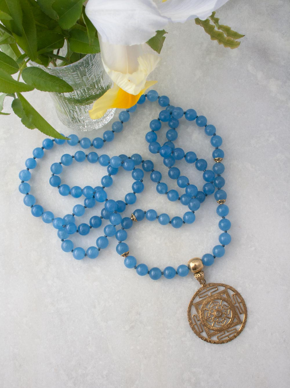 Beyond Infinity Mala, in 10mm Avalon blue aventurine, with brass Guru and Mandala. Full view.