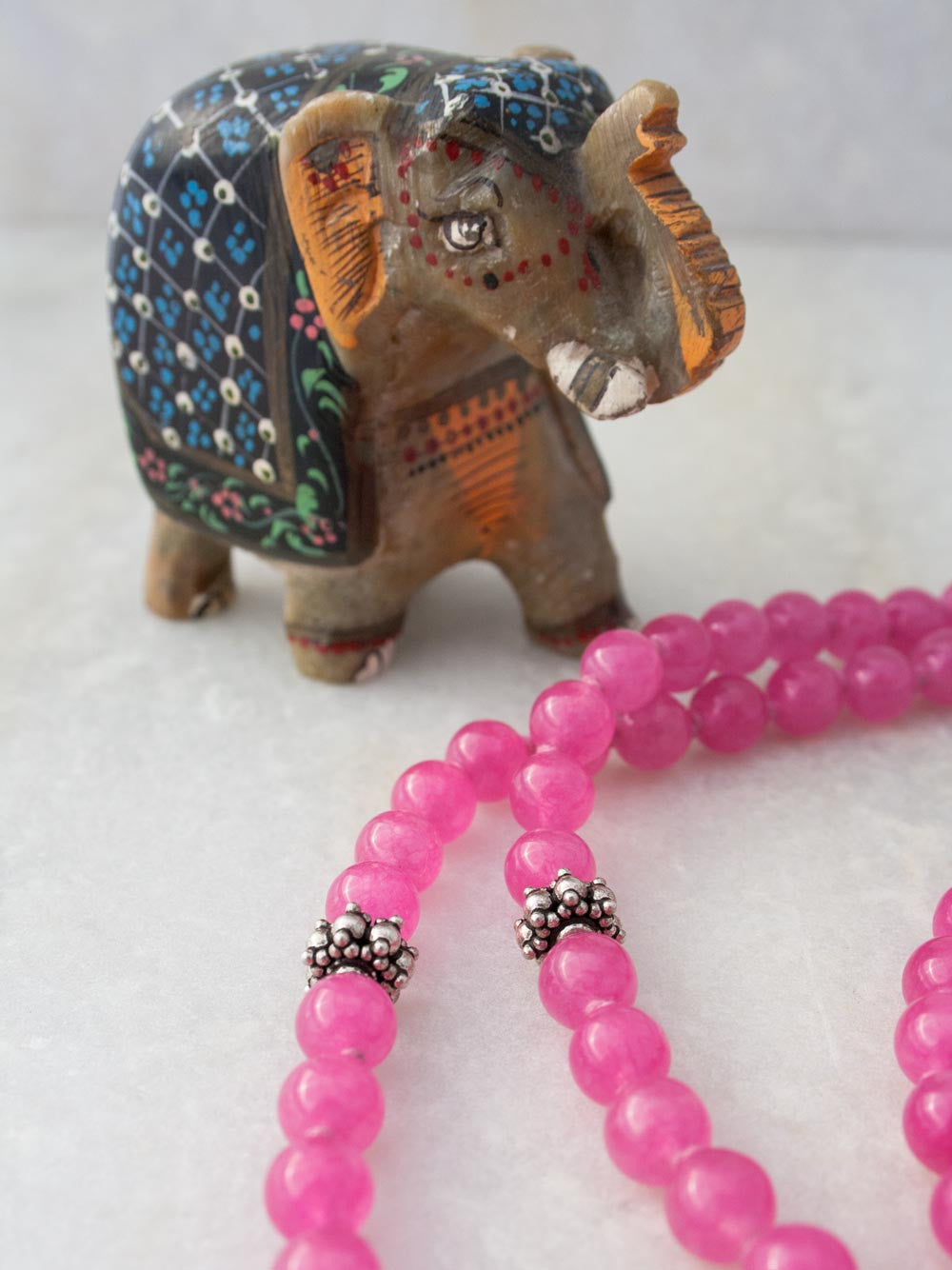 Ghunghroo Ganesh Mala, a merry dancer, in bougainville pink Aventurine with silver Ganesh & sari silk tassel: accents view
