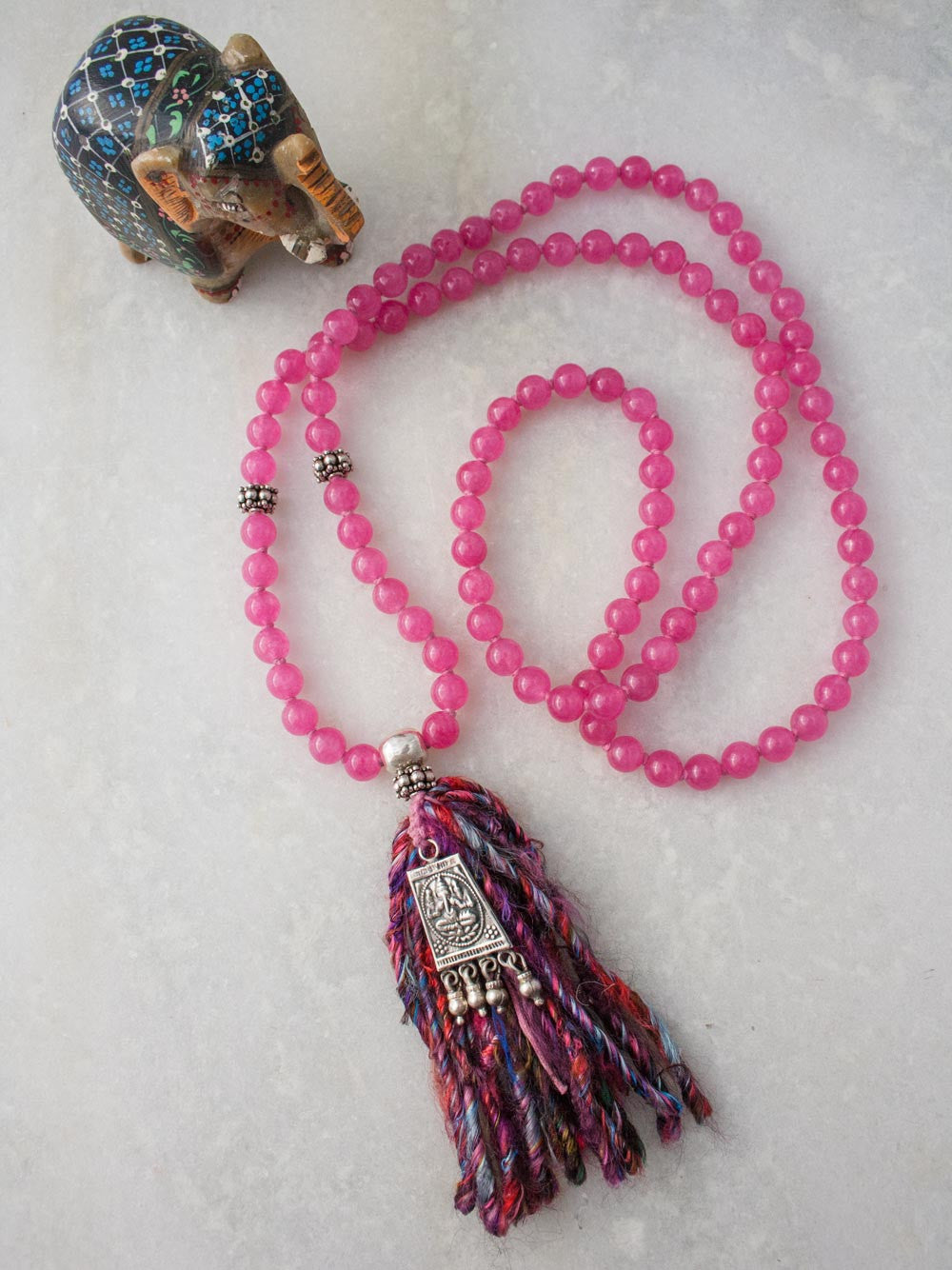 Ghunghroo Ganesh Mala, a merry dancer, in bougainville pink Aventurine with silver Ganesh & sari silk tassel: full view
