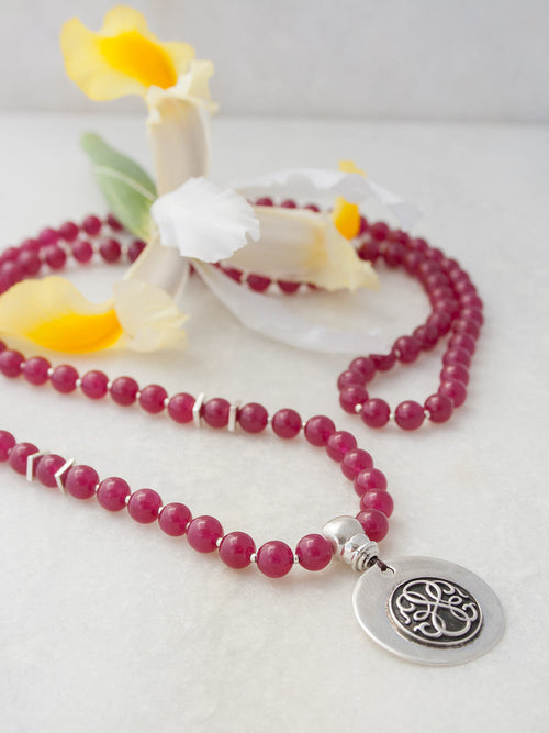 Odyssey Celebration Mala, in 8mm crimson red aventurine, has 925 silver Guru and Path of Life. Full view
