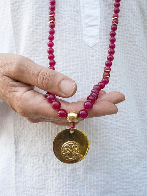 Odyssey Meditation Mala, in 10mm hand-knotted crimson red aventurine, with brass Guru and Path of Life. Hand view